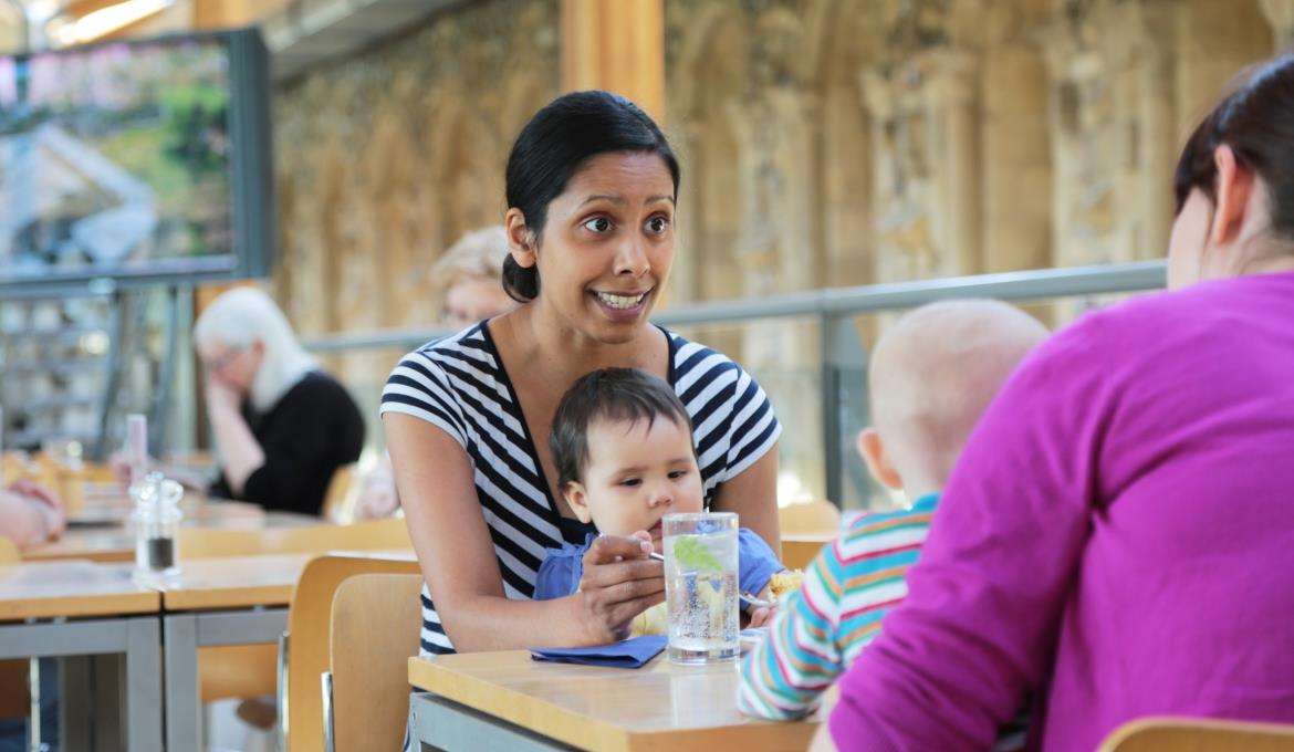 A family eating in the refectory