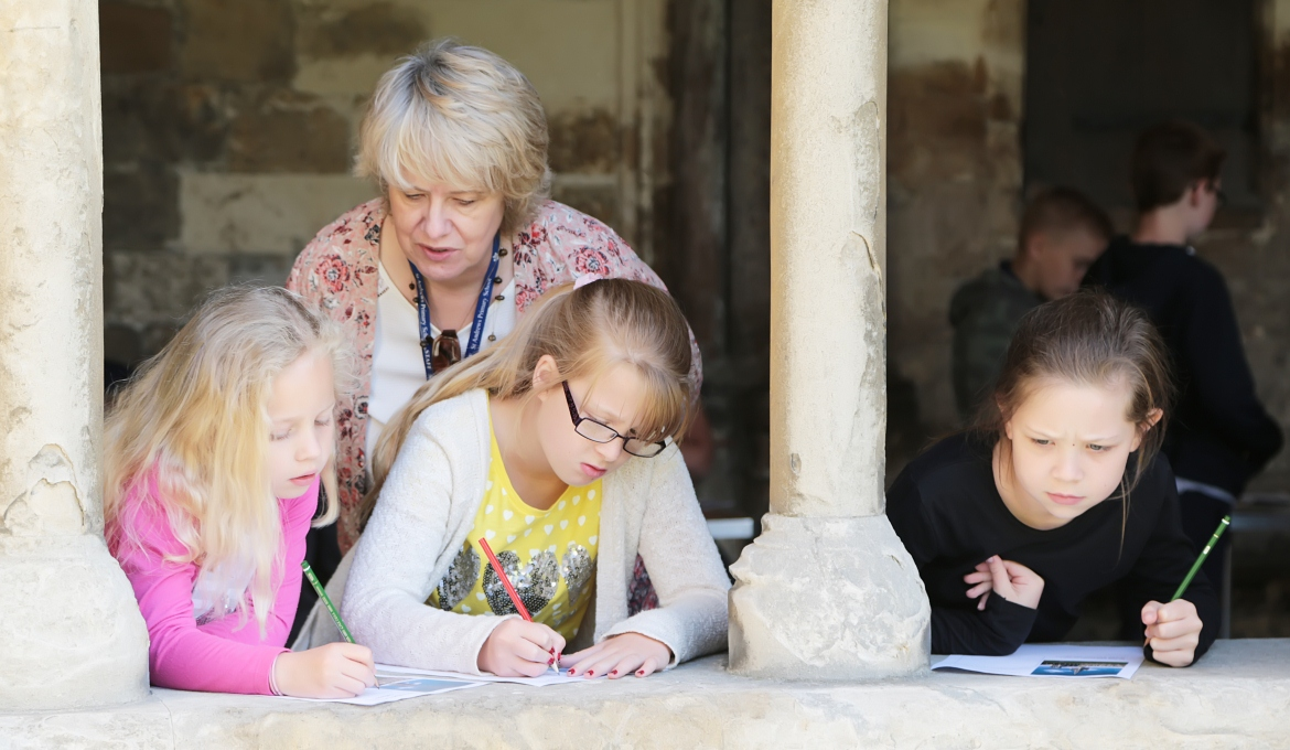A picture of some children sketching in the cloisters