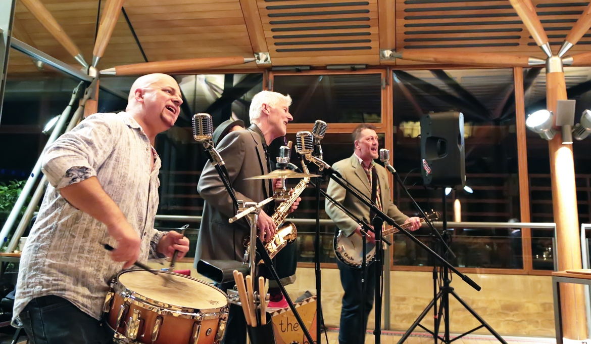 A picture of the He-Hews performing at a live music night