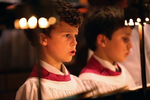A picture of choristers singing at Norwich Cathedral