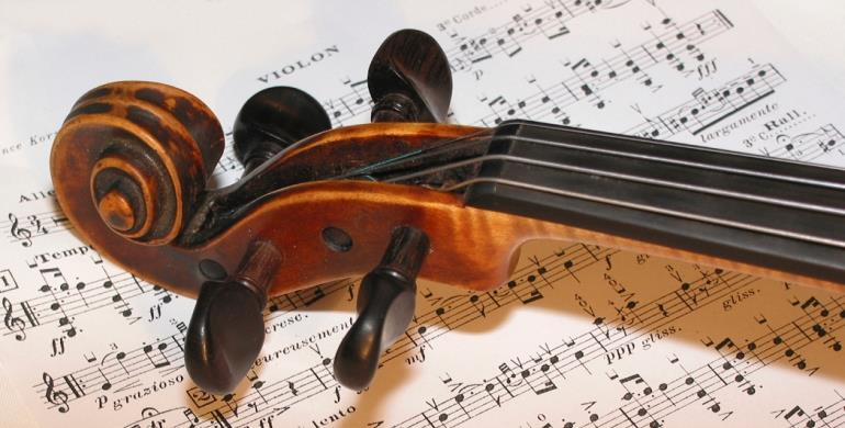 A picture of a violin and sheet music