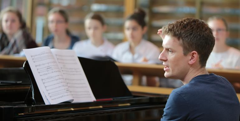 A picture of a rehearsal taking place in the Song School