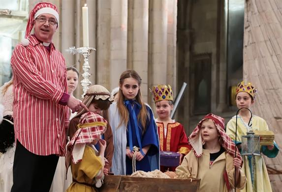 A picture of the Bishop and young people at last year