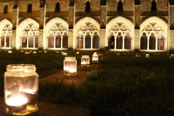 A picture of candles lining the Labyrinth at Norwich Cathedral